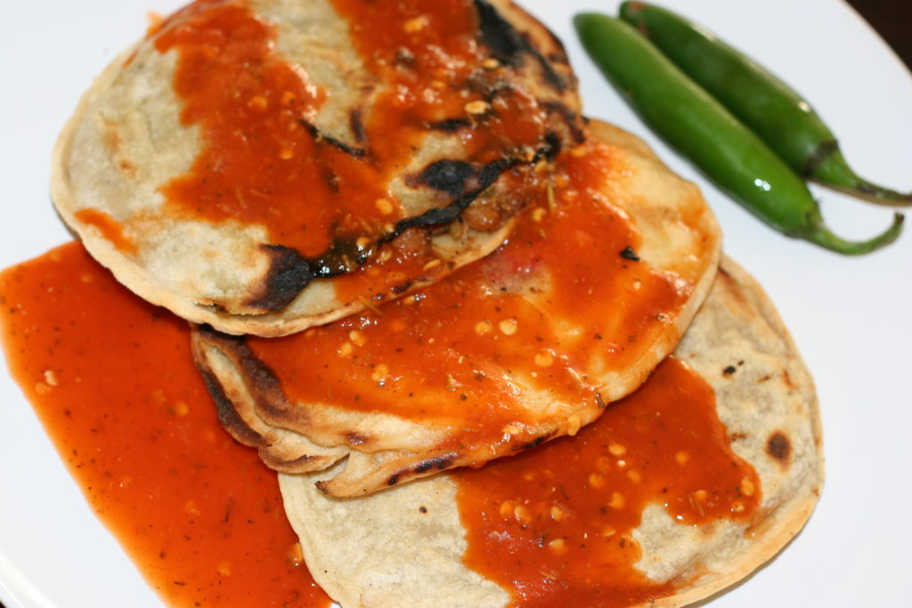 Gorditas al carbon with a spicy red salsa.